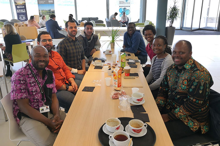 Members of the Africa Initiative chat over coffee