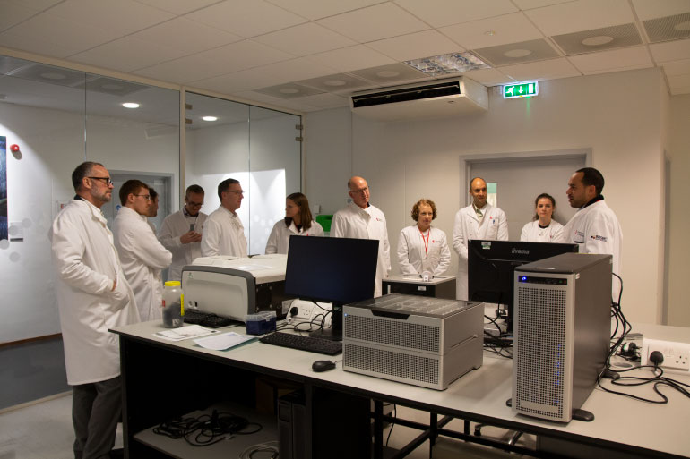 Participants are treated to a tour of our Genomics Pipelines lab, which includes this Oxford Nanopore PromethION.