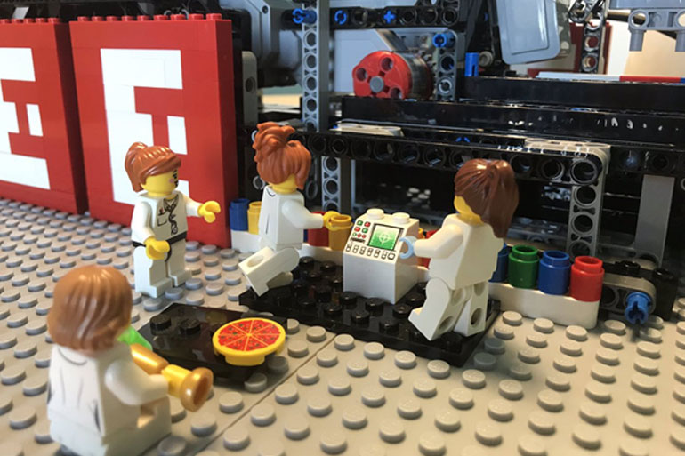 Scientists hard at work on the Brickopore: eating pizza not recommended in the lab