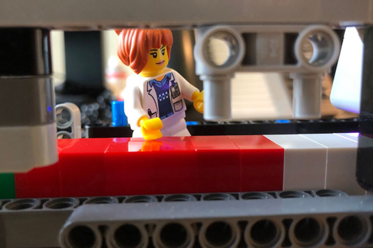 """The white blocks act like an """"adapter"""" and help calibrate the Blocksford Brickopore."""