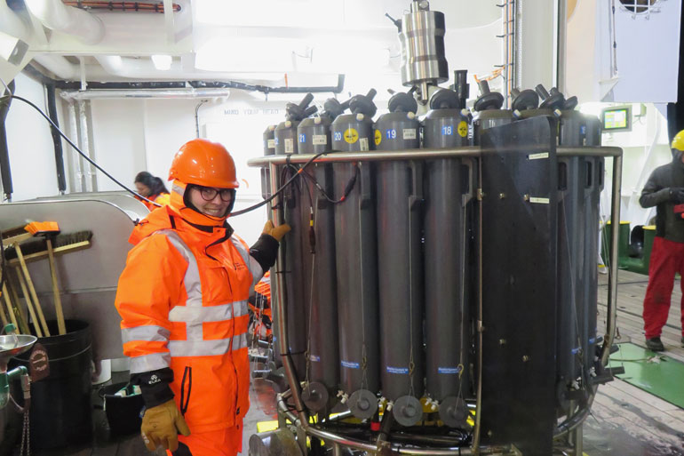 Preparing the water from the CTD rosette for filtering onboard the ship