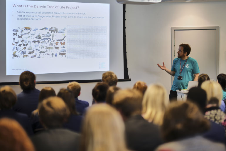 EI Director Neil Hall presenting the Darwin Tree of Life project to an engaged public audience at Inside EI Open Day 2019