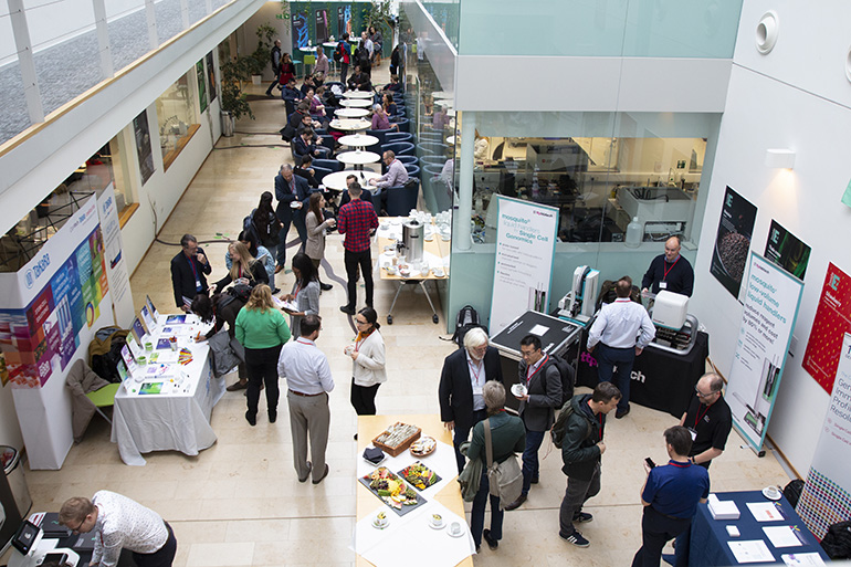 Image: Networking taking place in the Atrium at Earlham Institute before an event starts