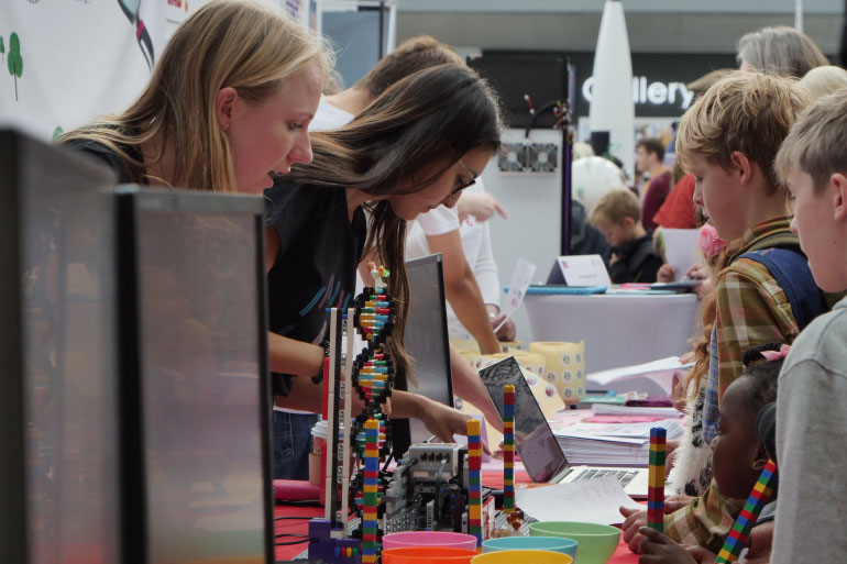 Our Year in Industry students helping out with public engagement using the EI Lego DNA sequencer at Norwich Science Festival