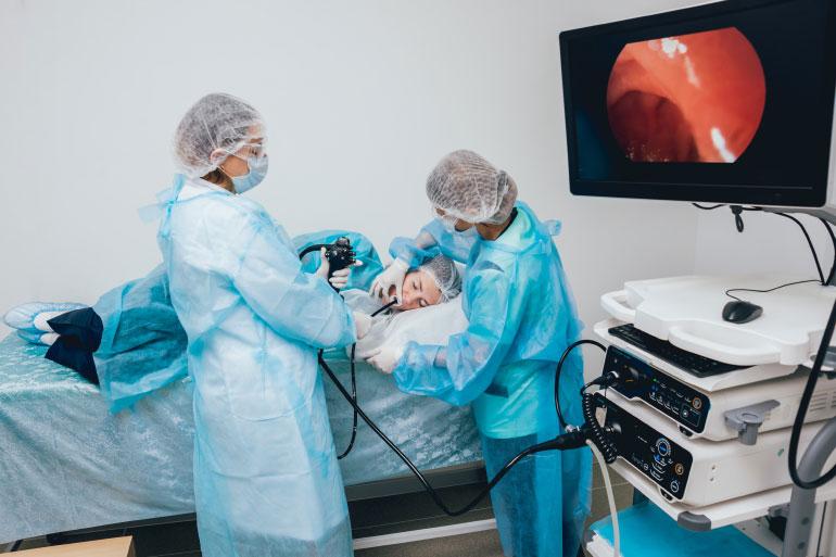 Patient undergoing endoscopy procedure to assess prognosis of IBD