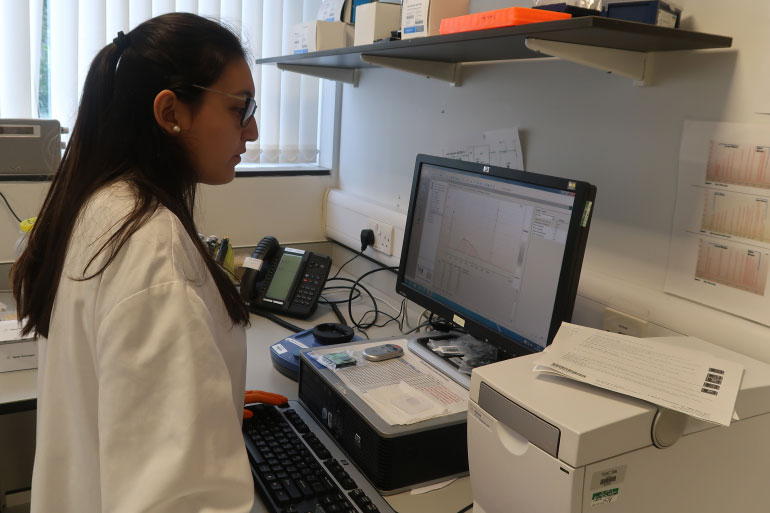 Elena Rodriguez using computer in the lab