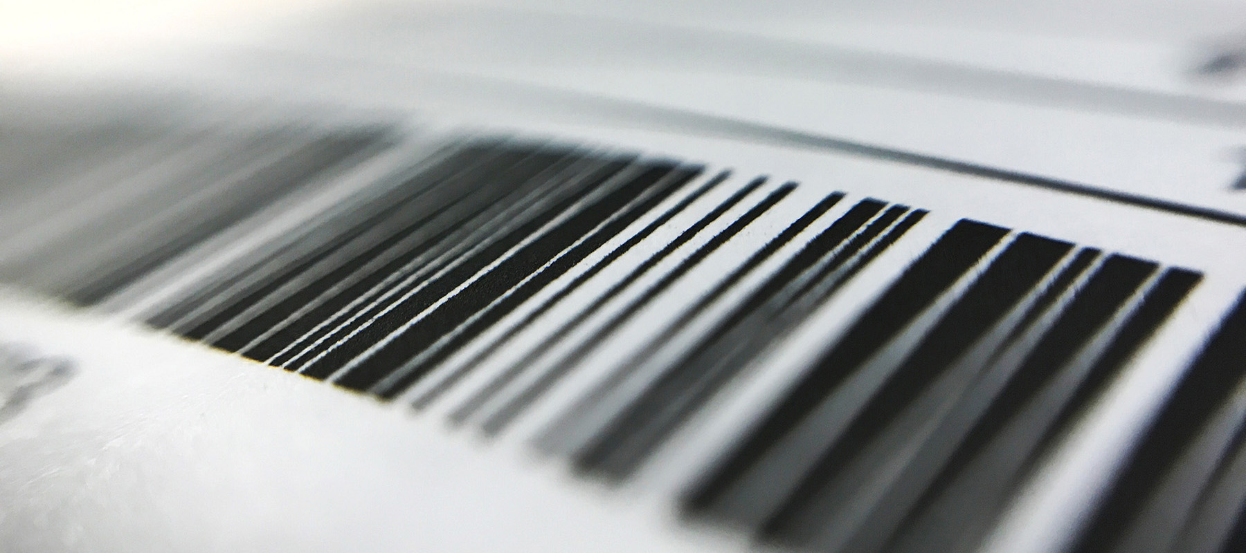 Image of a product barcode with thick and thin straight black lines on an off-white background